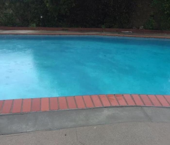 Storm Damage Rain Overflowing Your Swimming Pool
