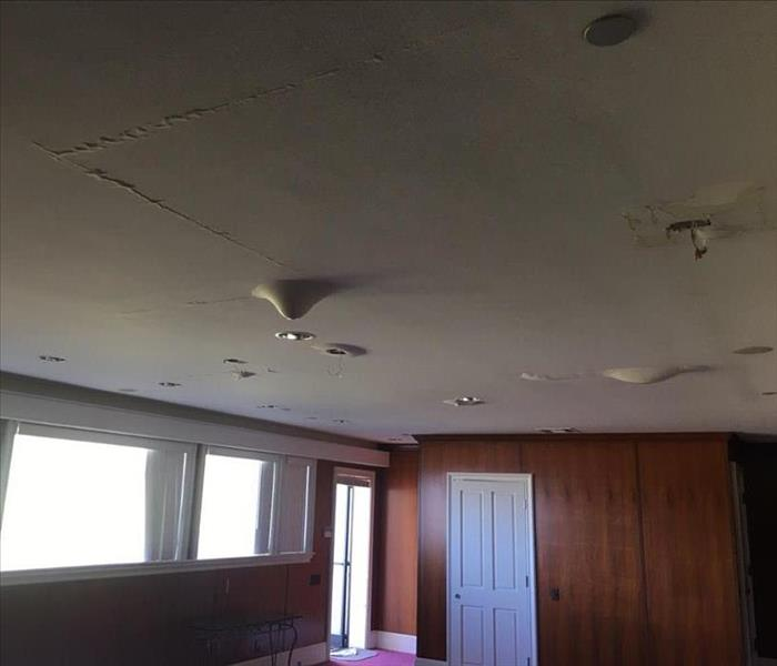 Roof leak caused severe damages inside a residence
